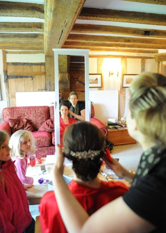 Karen Lowe of Karen's Beautiful Brides putting the finishing touches to the brides hair - best photo