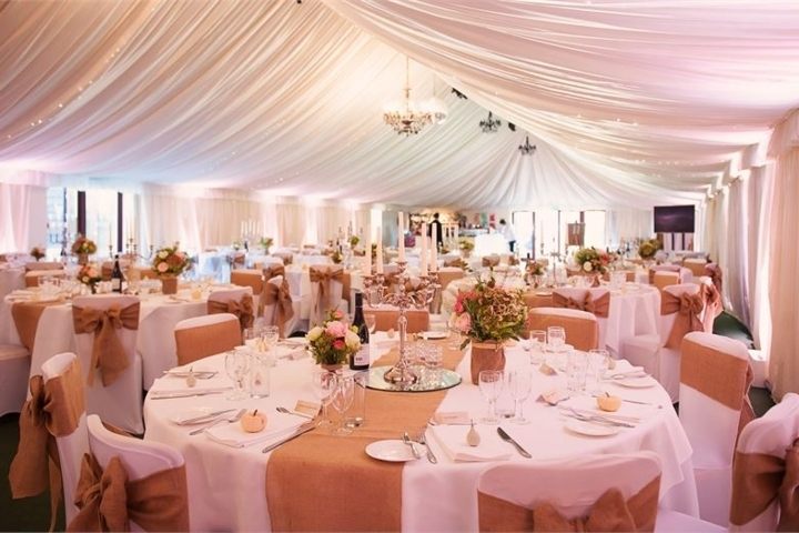 Inside Henley Manor Farm Barn, Suffolk wedding venue by Karen's Beautiful Brides.