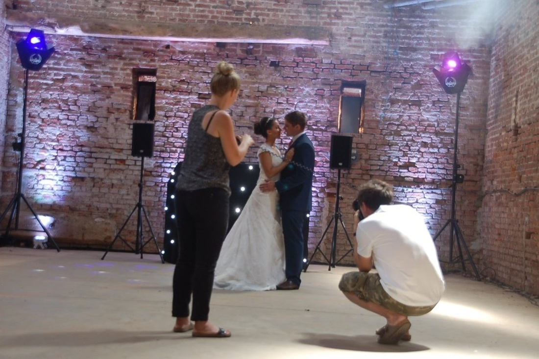 Taking photos of a brides at a wedding venue photoshoot in Copdock Hall Barn, Ipswich Suffolk