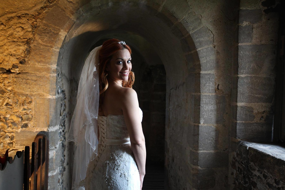 Photo of a bride at a wedding venue photoshoot in Hedingham Castle, Essex