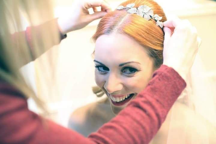 Karen of Karen's Beautiful Brides, preparing a bride for a photoshoot at Hedingham Castle, Essex