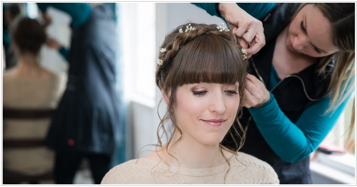 Best photo of Karen Lowe of Karen's Beautiful Brides putting the finishing touches to the brides hair
